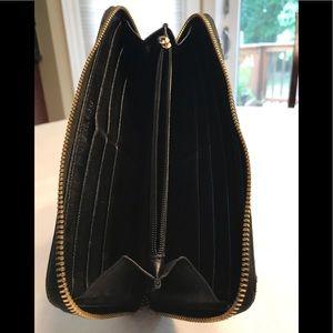 Michael Kors Bags - Michael Kors zipp-around Quilted Black Wallet